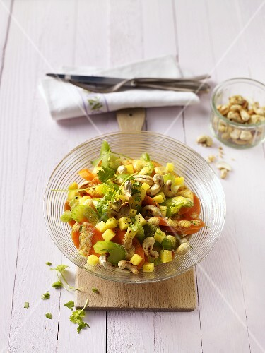 Carrot salad with mango and cashew nuts