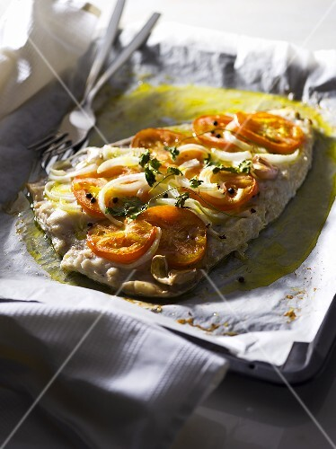 A fillet of fish with tomatoes