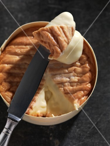 Epoisses (soft cheese from France) in wooden packaging