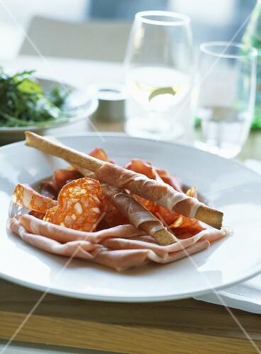 Mortadella, salami and Serrano ham with grissini