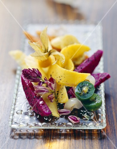 Colourful fruit salad with olive oil and black pepper