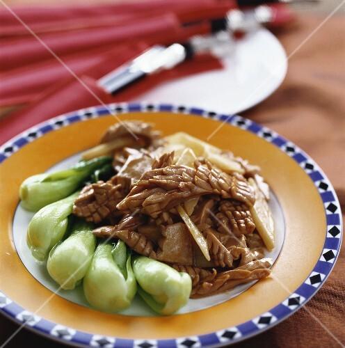 Pork kidneys with pak choi and yam