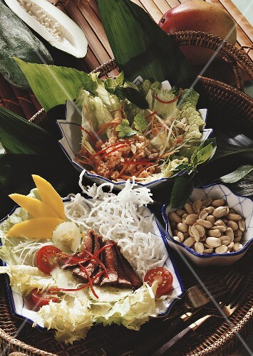 Papaya salad (Yam Ma La Kaw), beef salad (Nua Pad Prik)