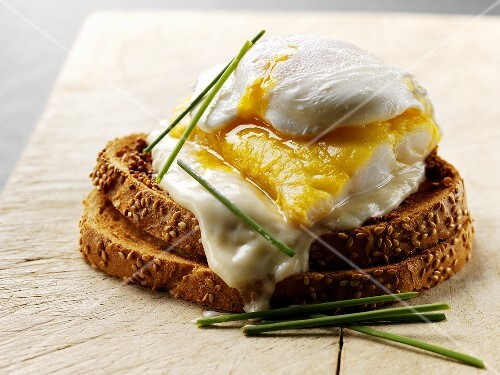 Poached egg and haddock on toasted bread
