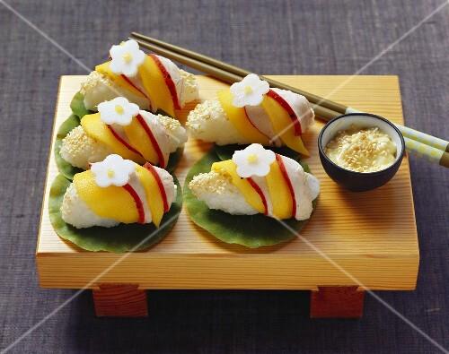 Nigiri sushi with chicken and mango