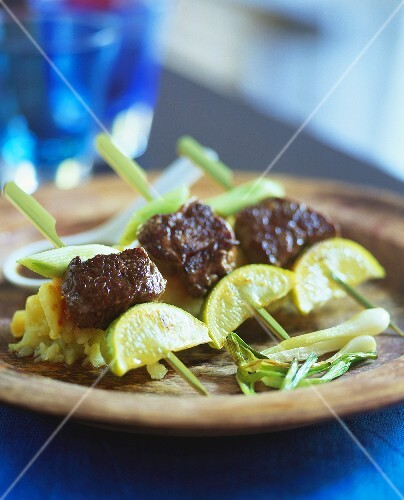 Grilled skewered meat with potato salad