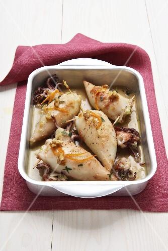 Calamari with cabbage stuffing, orange peel and walnuts