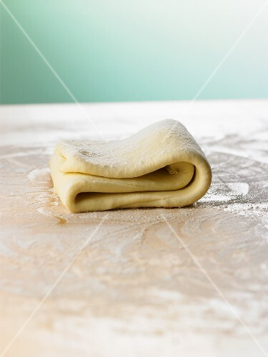 Quick puff pastry, folded on floured work surface