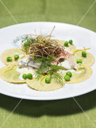 Char ravioli with herbs and peas