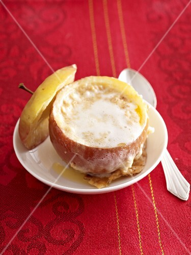 A baked apple with a marshmallow filling