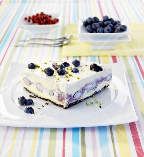 A quarter of a blueberry ice cream cake