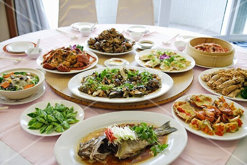 Assorted seafood dishes on plates on a table