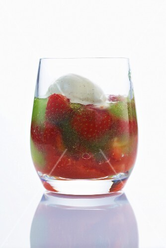 Olive ice cream with herb jelly and strawberries