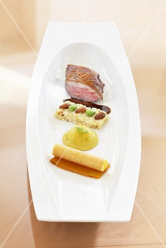 Duck breast with quince jelly and almond couscous