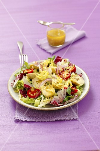 Salad with artichoke hearts, cherry peppers and onions with a garlic and mustard dressing