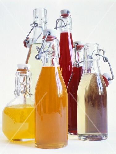 Various syrups in flip-top bottles