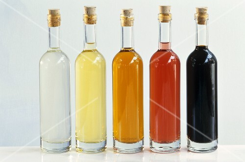 Five different vinegars in bottles