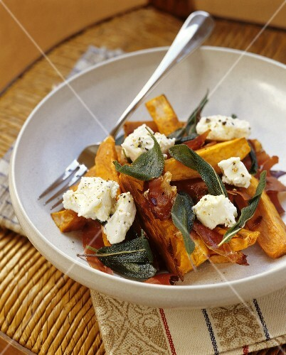 Sweet potato salad with ham, goat's cheese and sage