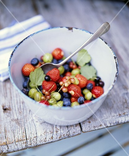Bowl of fresh berries on a wooden table