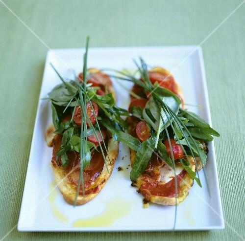 Bruschetta with pancetta, tomatoes and herbs