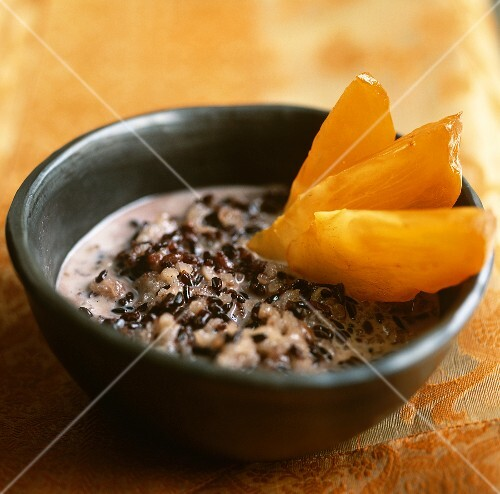 Sweet rice and azuki beans in coconut milk with persimmon