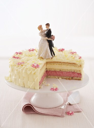 A wedding cake with a section removed
