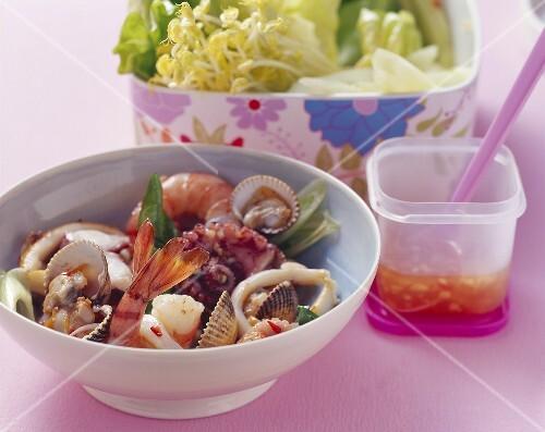 Asian seafood salad with salad leaves