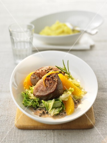 Veal medallions with Chinese cabbage and orange fillets