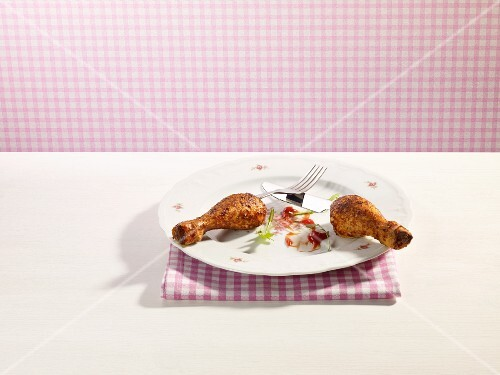 Fried chicken drumsticks as cutlery handles