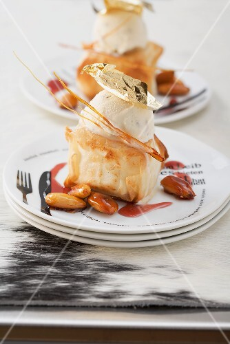 Baked goats' cheese with ice cream, gold leaf and roasted almonds