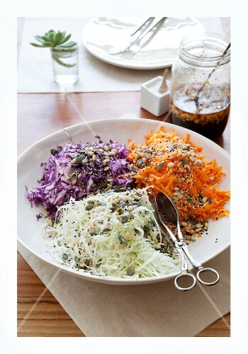 A plate of raw vegetables with seeds