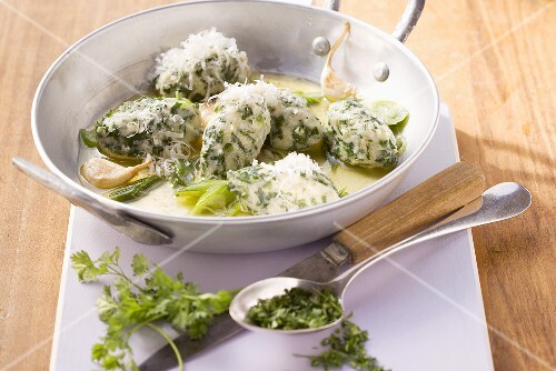 Spinach and quark gnocci with garlic and chervil butter