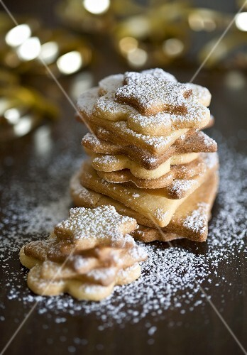 Christmas biscuits with icing sugar, stacked