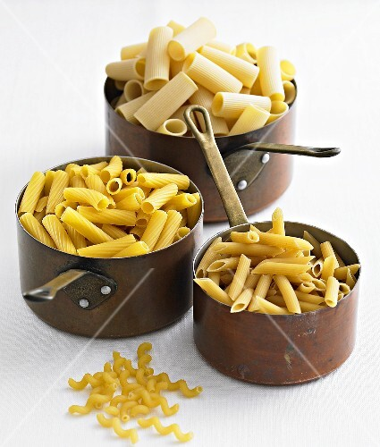 Various types of pasta in pans