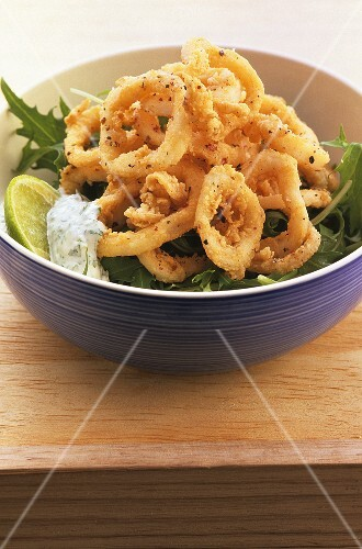 Deep-fried squid rings with chervil sauce
