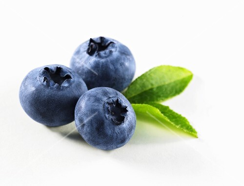 Three blueberries with leaves (close-up)