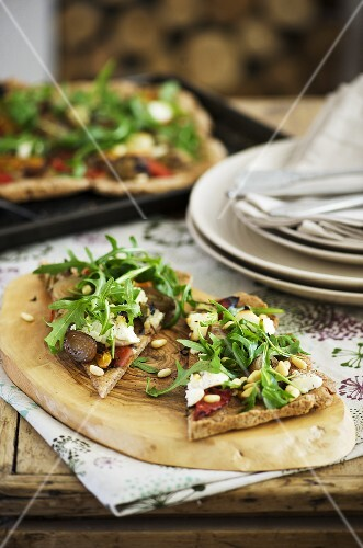 Wholemeal pizza topped with grilled vegetables, ricotta & rocket
