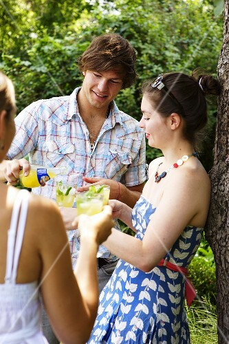 Young people drinking Orangina cocktails