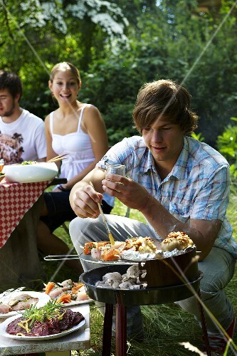 Young people at Italian barbecue