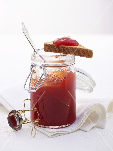 Strawberry spread with Prosecco in jar and on toast triangle