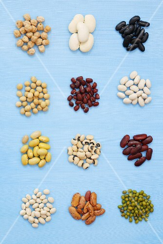 Various kinds of beans on blue background