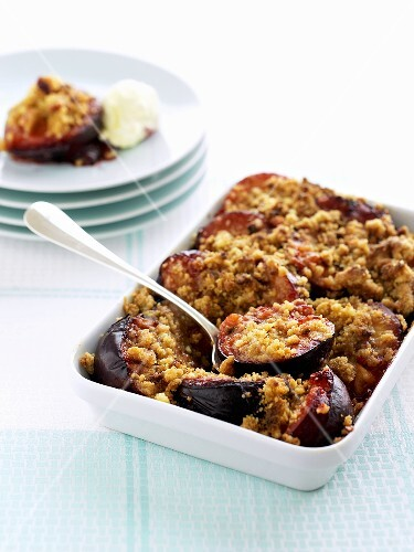 Plum crumble in baking dish and on plate