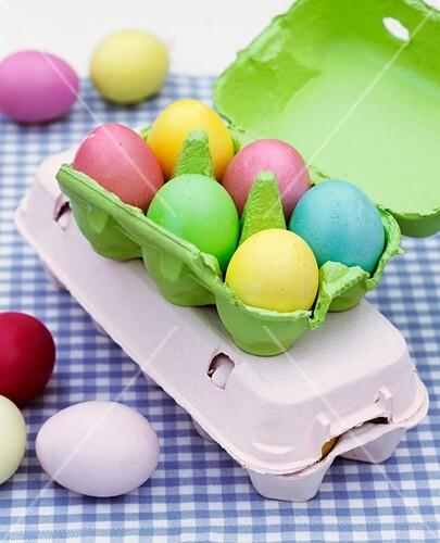 Coloured Easter eggs in egg box