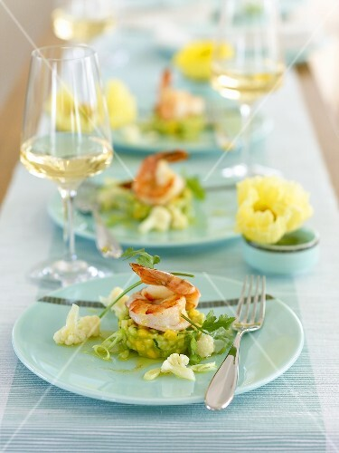 Prawns on mango and avocado salad