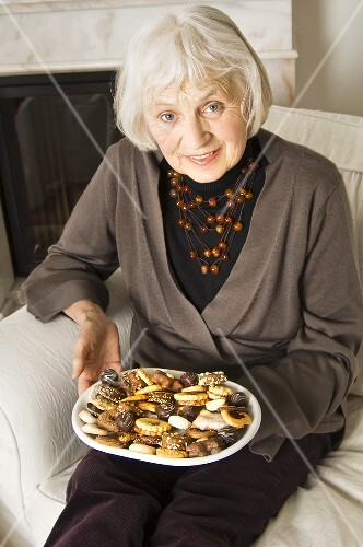 Elderly lady with biscuits