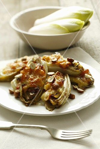Baked chicory with pancetta and hazelnuts