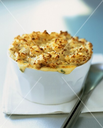 Seafood pie with mustard mashed potato and cheese topping