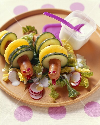 Frankfurter, potato and cucumber snakes with salad