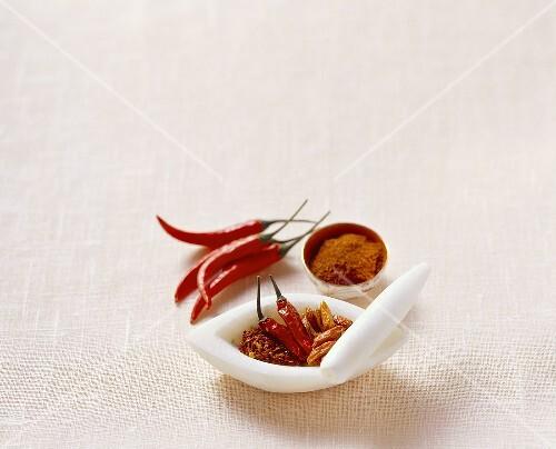 Chili peppers, fresh and dried, chili flakes and chili powder