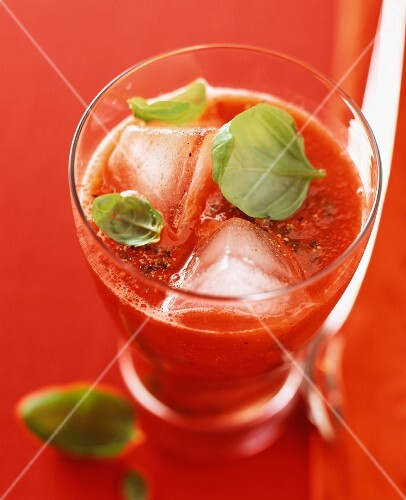 Tomato and basil drink with ice cubes